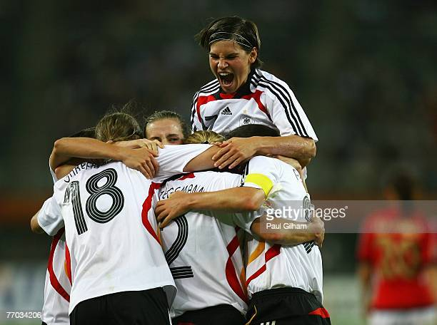 Ariane Hingst celebrates with her teammates after Kerstin Stegemann of Germany scored the second goal for Germany during the Semi Final of the...