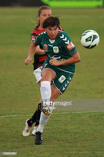 Ariane Hingst of Canberra kicks the ball during the round 11 WLeague match between Canberra United and the Western Sydney Wanderers at McKellar Park...