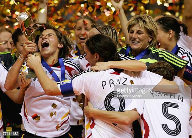 Ariane Hingst of Geremany holds the winning trophee and Birgit Prinz and Silke Rottenberg celebrat wit her winning the Women's World Cup 2007 Final...