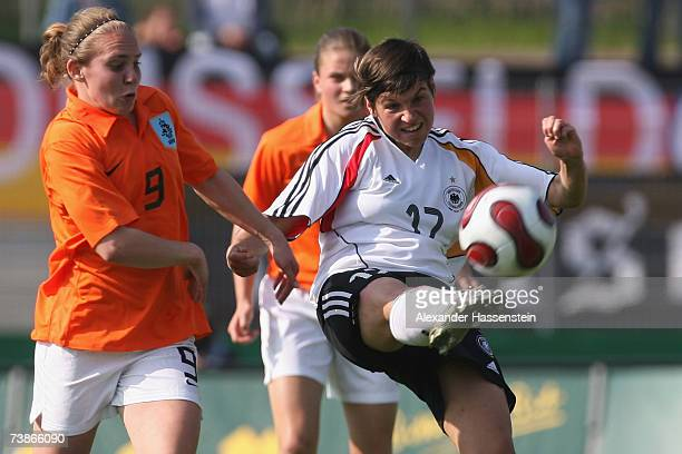 Ariane Hingst of Germany challenge for the ball with Manon Melis of the Netherlands during the UEFA Womens Championship qualification round match...