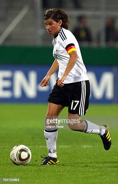 Ariane Hingst of Germany runs with the ball during the Women's International Friendly match between Germnay and Canada at Rudolf Harbig stadium on...
