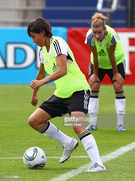 Ariane Hingst of Germany stops the ball during the Germany Women national team training session at Wurfplatz stadium on June 23 2011 in Berlin Germany