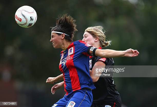 Ariane Hingst of Newcastle competes for the ball against Marijana Rajcic of Adelaide during the round two WLeague match between the Newcastle Jets...