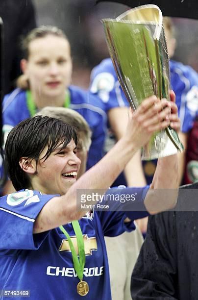 Ariane Hingst of Potsdam celebrates winning the Women's DFB German Cup final between 1FFC Turbine Potsdam and 1FFC Frankfurt at the Olympic Stadium...