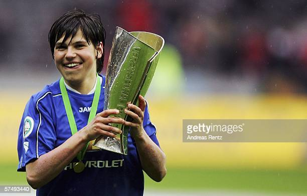 Ariane Hingst of Potsdam celebrates with the German Cup after winning the Women's DFB German Cup final between 1FFC Turbine Potsdam and 1FFC...