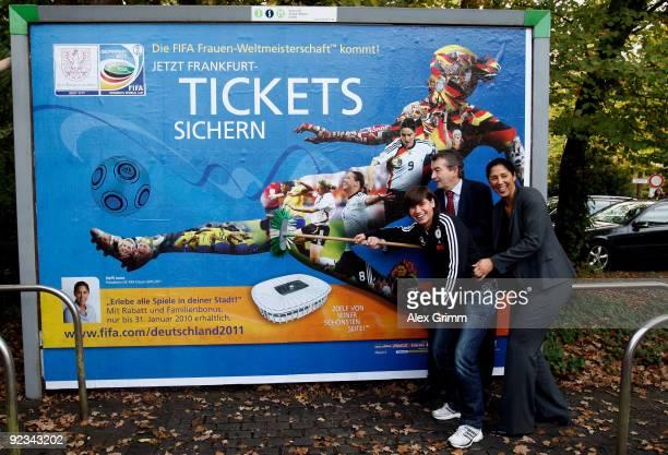 Ariane Hingst of the German national football team DFB secretary general Wolfgang Niersbach and Steffi Jones president of the FIFA OK Germany 2011...