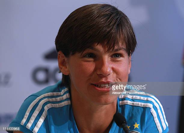 Ariane Hingst of the German woman national team smiles during a press conference at the adidas headquater on May 19 2011 in Herzogenaurach Germany