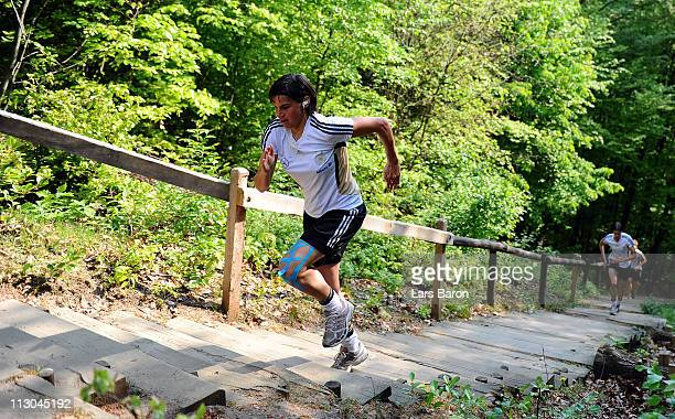 Ariane Hingst runs up the Glessen stairs during a German Women National Team training session at Villaforstpark on April 23 2011 in Brauweiler Germany
