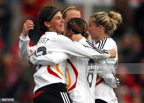 Ariane Hingst Sandra Smisek and Simone Laudehr of Germany celebrate after the 30 during the 2009 UEFA European Championship Qualifying match between...
