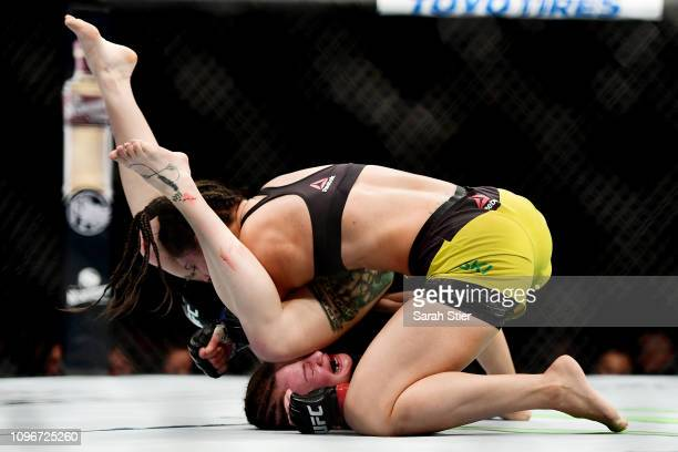Ariane Lipski of Brazil fights against Joanne Calderwood of Scotland during their Women's Flyweight fight at UFC Fight Night at Barclays Center on...