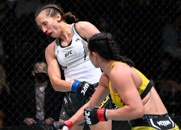 Ariane Lipski of Brazil punches Mandy Bohm of Germany in a flyweight fight during the UFC Fight Night event at UFC APEX on September 18, 2021 in Las...