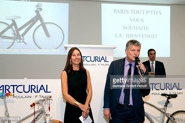Ariane Poniatowski and auctioneer Francois Tajan attend 'Arty Bike' Auction to benefit Association des Tout P'tits at Artcurial on June 20 2013 in...