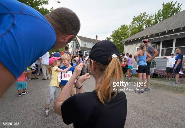 Ariane Vinet turns to her brother Alexis while their mother Catherine Awad takes their photo and their father Dominic Vinet watches before the start...