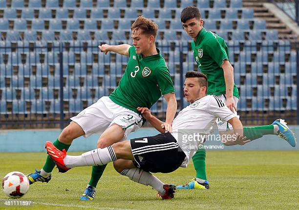 Arianit Ferati of Germany is challenged by Anthony Breslin of Ireland during the UEFA Under17 Elite Round between Germany and Ireland at Stadion FC...