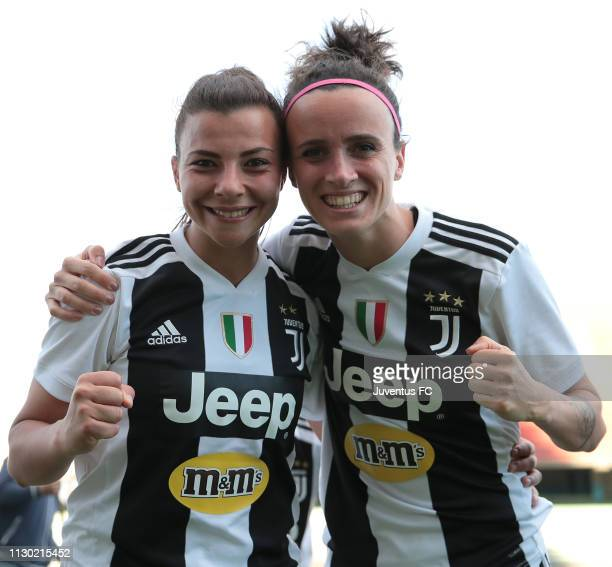 Arianna Caruso of Juventus Women celebrates the victory with teammate Barbara Bonansea at the end of the Women Coppa Italia match between AC Milan...