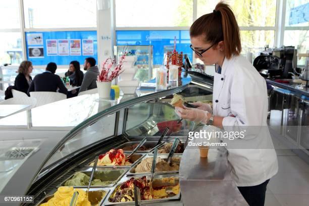 Arianna Casini a Gelato Museum guide prepares a gelato cone at the Carpigiani company's onsite gelateria on March 28 2017 in Bologna Italy Italian...