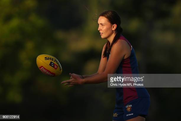 Arianna Clarke handballs during a Brisbane Lions AFL training session at Leyshon Park on January 15 2018 in Brisbane Australia