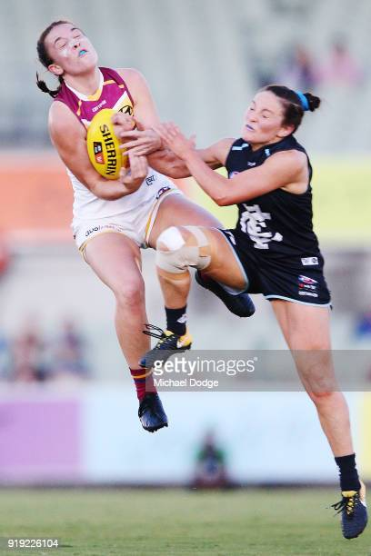 Arianna Clarke of the Lions marks the ball against Shae Audley of the Blues during the round three AFLW match between the Carlton Blues and the...