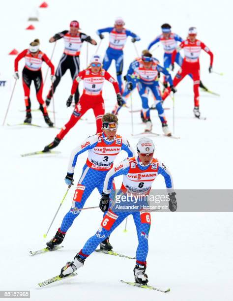 Arianna Follis and Marianna Longa of Italy head the field during the Ladies Cross Country 30KM race at the FIS Nordic World Ski Championships 2009 on...