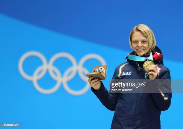 Arianna Fontana from Italy kissing her gold medal during the awards ceremony of the women's 500m speed skating event of the 2018 Winter Olympics in...