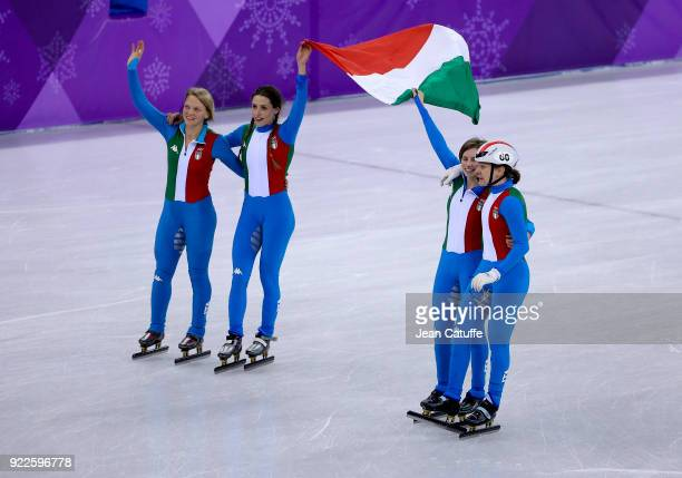 Arianna Fontana Lucia Peretti Cecilia Maffei and Martina Valcepina of Italy celebrate their silver medal in Short Track Speed Skating Ladies 3000m...