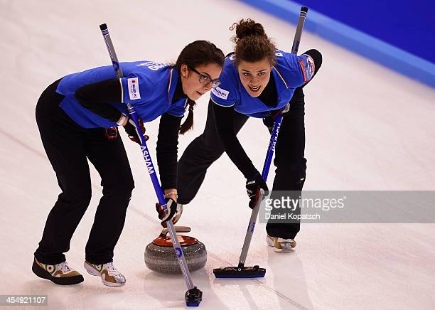 Arianna Losano of Italy and team mate Elisa Patono sweep during the Olympic Qualification Tournament match between Italy and Latvia on December 10...