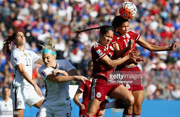 Arianna Romero of Mexico and Annia Mejia of Mexico control the ball against Alex Morgan of USA and Jiulie Johnston of USA in the second half of the...