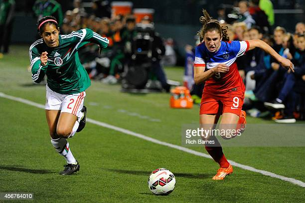 Arianna Romero of Mexico and Heather O'Reilly of the United States react to a loose ball during the second half of the match at Sahlen's Stadium on...