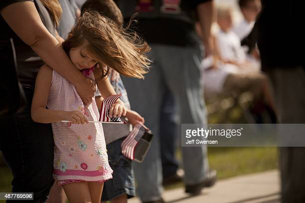 Arianna Scully of Columbia Maryland leans against her mother Sarah during services at the Flight 93 National Memorial during the 14th anniversary of...