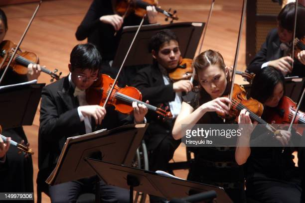 """Arianna Warsaw-Fan performing Lutoslawski's """"Partita for Violin and Orchestra"""" with the Juilliard Orchestra led by Jeffrey Milarsky at Alice Tully..."""