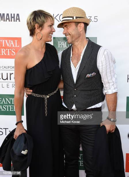 Arianne Zucker and Shawn Christian arrive at the Festival of Arts Celebrity Benefit Event on August 25 2018 in Laguna Beach California