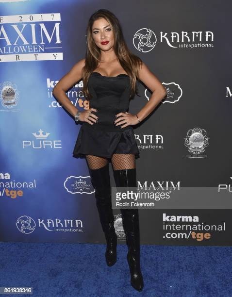 Arianny Celeste arrives at the 2017 MAXIM Halloween Party at LA Center Studios on October 21 2017 in Los Angeles California