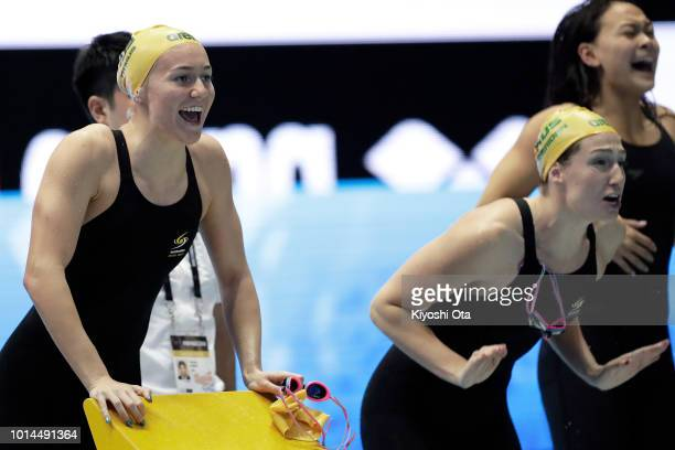 Ariarne Titmus and Mikkayla Sheridan of Australia cheer their teammate in the Women's 4x200m Freestyle Relay on day two of the Pan Pacific Swimming...