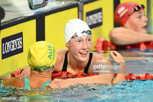 Ariarne Titmus of Australia embraces Taylor Ruck of Canada following the Women's 200m Freestyle Final on day one of the Gold Coast 2018 Commonwealth...