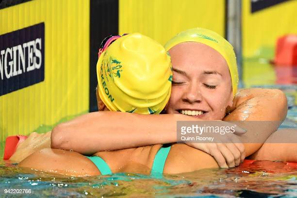 Ariarne Titmus of Australia embraces teammate Emma Mckeon of Australia following the Women's 200m Freestyle Final on day one of the Gold Coast 2018...