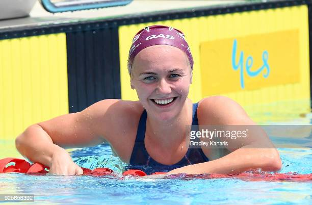 Ariarne Titmus smiles after competing in the heats of the Women's 400m Freestyle event during the 2018 Australia Swimming National Trials at the...