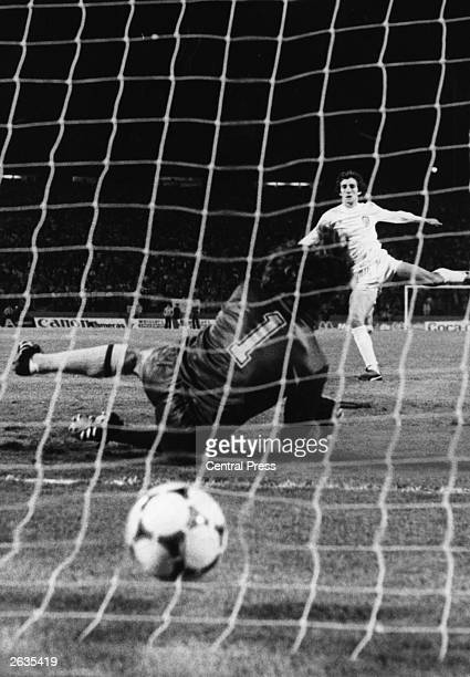 Arias Marque of Valencia scores the winning penalty in a penalty shoot out beating Arsenal goalkeeper Pat Jennings in the European Cup Winners Cup...