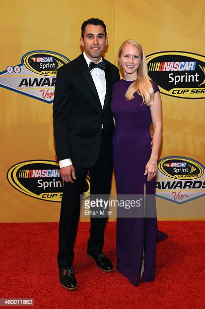 Aric Almirola and his wife Janice Almirola arrive on the red carpet prior to the 2014 NASCAR Sprint Cup Series Awards at Wynn Las Vegas on December 5...