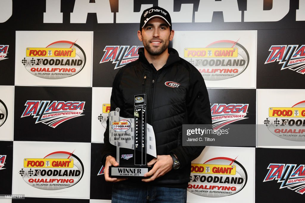 Aric Almirola, driver of the #43 Charter Ford, celebrates with the Food Giant Foodland Qualifying Day Award after being awarded the pole position for the NASCAR Sprint Cup Series 45th Annual Camping World RV Sales 500 at Talladega Superspeedway on October 19, 2013 in Talladega, Alabama. Qualifying was cancelled due to rain and Almirola was awarded the pole position with the fastest time in the first Sprint Cup practice.