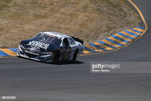 Aric Almirola driver of the DenBeste Water Solutions Ford races during the NASCAR KN Pro Series West Carneros 200 at Sonoma Raceway on June 23 2018...