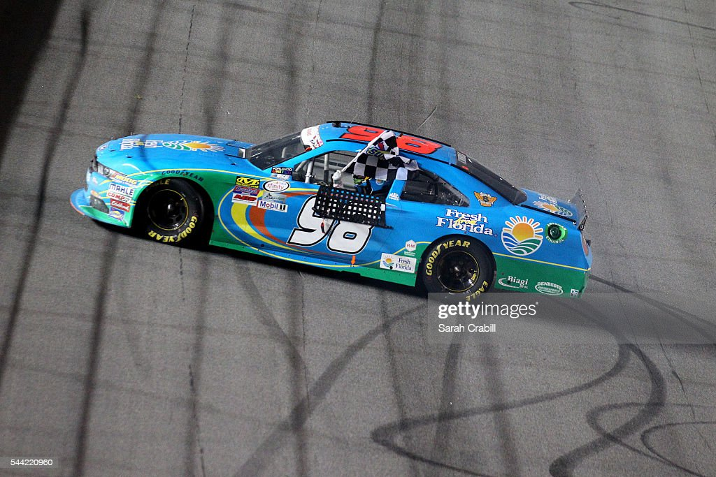 Aric Almirola, driver of the #98 Fresh From Florida Ford, celebrates with the checkered flag after winning the NASCAR XFINITY Series Subway Firecracker 250 at Daytona International Speedway on July 1, 2016 in Daytona Beach, Florida.