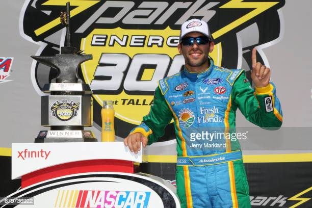 Aric Almirola driver of the Fresh from Florida Ford poses in Victory Lane after winning the NASCAR XFINITY Series Sparks Energy 300 at Talladega...