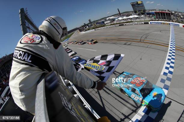 Aric Almirola driver of the Fresh from Florida Ford takes the checkered flag to win the NASCAR XFINITY Series Sparks Energy 300 at Talladega...