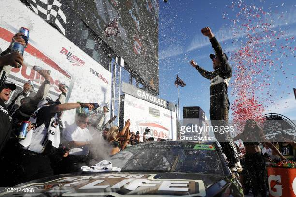 Aric Almirola driver of the Smithfield Bacon for Life Ford celebrates in Victory Lane after winning the Monster Energy NASCAR Cup Series 1000Bulbscom...