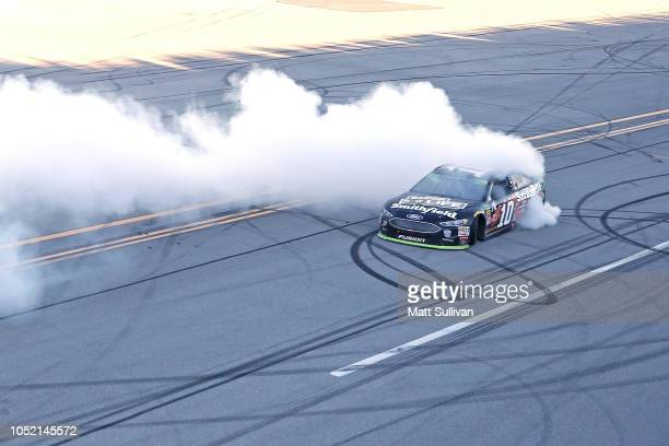 Aric Almirola driver of the Smithfield Bacon for Life Ford celebrates after winning the Monster Energy NASCAR Cup Series 1000Bulbscom 500 at...