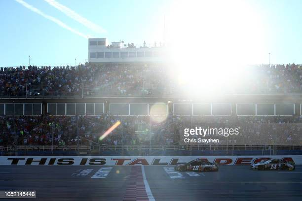 Aric Almirola driver of the Smithfield Bacon for Life Ford crosses the finish line to win the Monster Energy NASCAR Cup Series 1000Bulbscom 500 at...