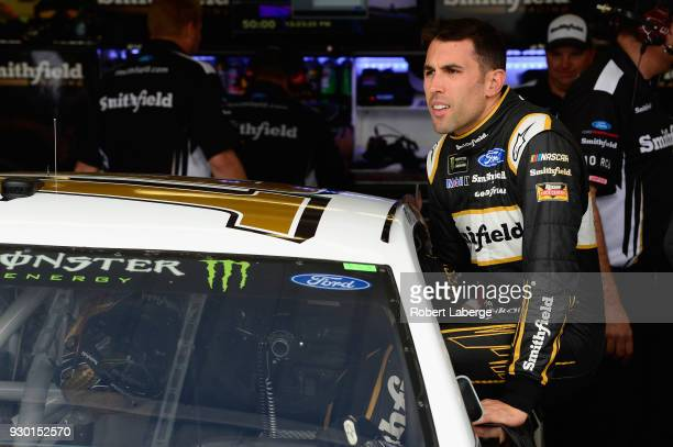 Aric Almirola driver of the Smithfield Ford climbs into his car during practice for the Monster Energy NASCAR Cup Series TicketGuardian 500 at ISM...
