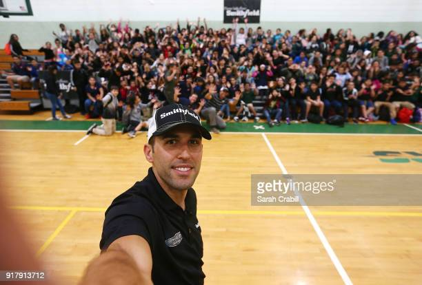 Aric Almirola driver of the Smithfield Ford Fusion for StewartHaas Racing in the Monster Energy NASCAR Cup Series takes a selfie with honorroll...