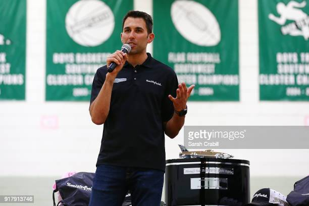 Aric Almirola driver of the Smithfield Ford Fusion for StewartHaas Racing in the Monster Energy NASCAR Cup Series speaks to honorroll students at...