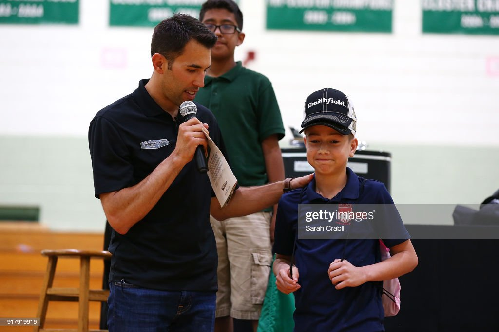 Aric Almirola, driver of the #10 Smithfield Ford Fusion for Stewart-Haas Racing in the Monster Energy NASCAR Cup Series, visits honor-roll students at Pierce Middle School on February 13, 2018 in Tampa, Florida.